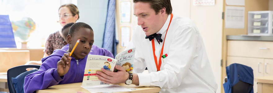 teacher-in-bow-tie-reading-with-student