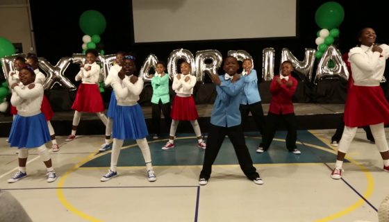 group of children dancing in a gym
